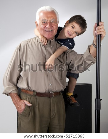 Grandfather and grandson posing for the camera - stock photo