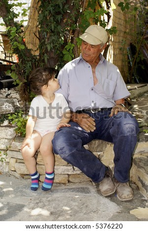 Grandfather and his  granddaughter - stock photo