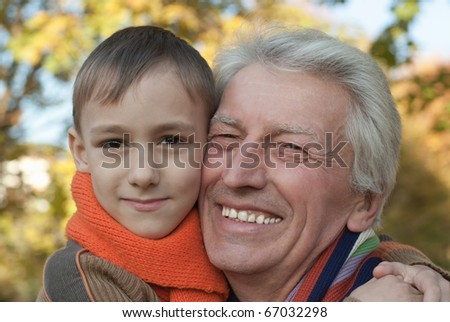 grandfather and his grandson in an outdoor