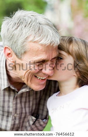 grandfather and his little granddaughter together - stock photo