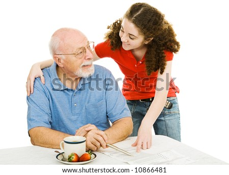 Grandfather and teen granddaughter enjoy spending time together.  Isolated on white. - stock photo