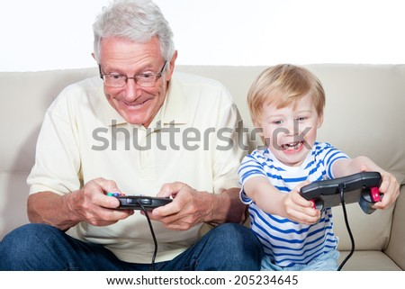 grandfather child game console - stock photo