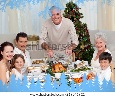 Grandfather cutting turkey for Christmas dinner against frost and fir trees in blue - stock photo