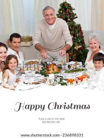 Grandfather cutting turkey for Christmas dinner against happy christmas - stock photo