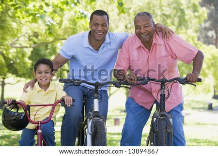 Grandfather grandson and son bike riding - stock photo