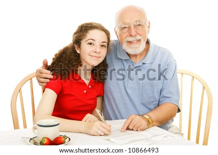 Grandfather helping his teen granddaughter fill out an absentee ballot.  Isolated on white. - stock photo