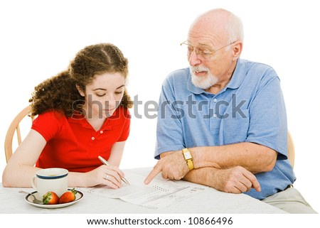 Grandfather helping teen girl fill out paperwork (absentee ballot).  Isolated on white. - stock photo