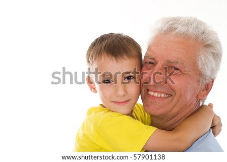 grandfather keeps his grandson on a white background