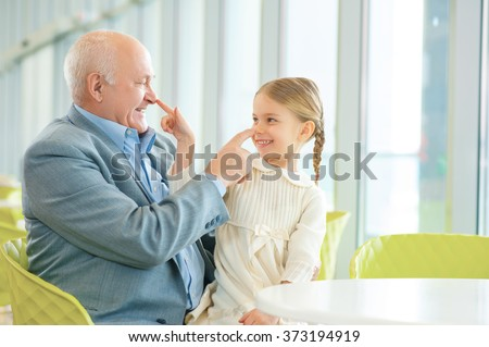 Grandfather meeting his cute granddaughter. - stock photo