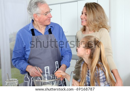 Grandfather, mother and daughter baking - stock photo