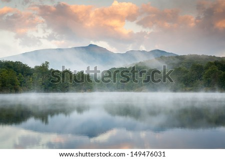 Grandfather Mountain Sunrise Reflections on Julian Price Lake in the Blue Ridge Mountains of Western North Carolina - stock photo