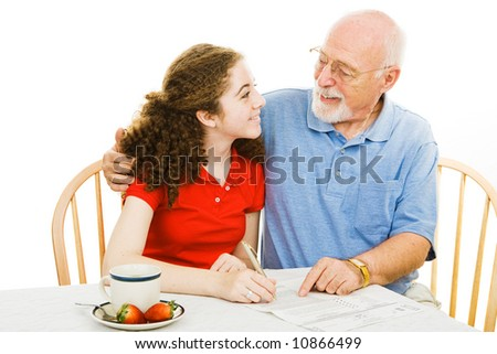 Grandfather offering help and guidance to his teen-aged granddaughter.  Isolated on white. - stock photo