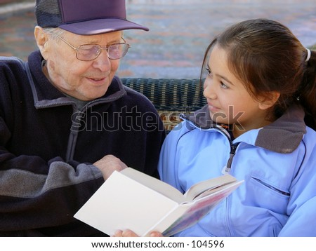 Grandfather reading a book - stock photo
