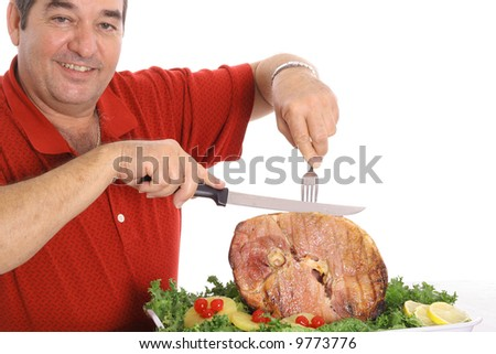 grandfather slicing a ham - stock photo