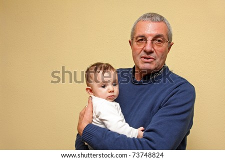 grandfather with baby grandson - stock photo