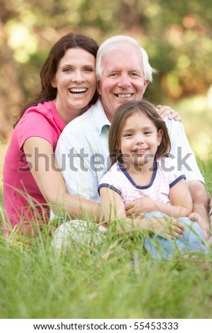Grandfather With Daughter And Granddaughter In Park - stock photo