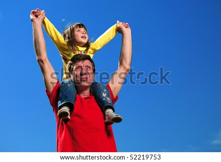 grandfather with granddaughter under blue sky - stock photo
