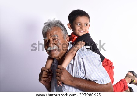 Grandfather with his grandson as they play together - stock photo