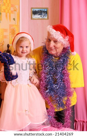 grandfather with little girl in christmas hat - stock photo