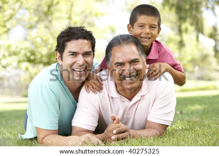 Grandfather With Son And Grandson In Park - stock photo
