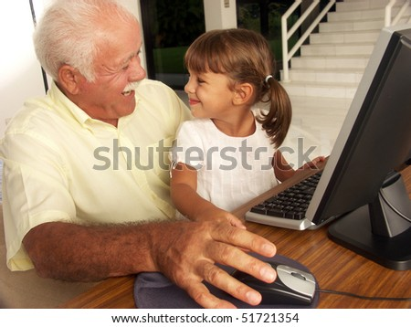 grandfathers and granddaughter sharing. - stock photo