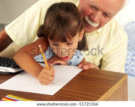 grandfathers and granddaughter studing. - stock photo