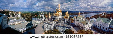 Grandiose beautiful view of the whole complex of the Kiev-Pechersk Lavra, taken from a high altitude monastery bell tower - stock photo