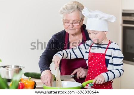 grandma grandson cooking together domestic kitchen stock photo
