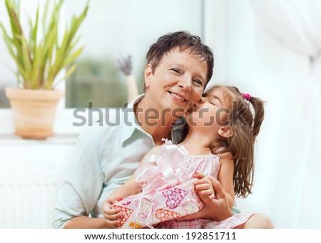 Grandma and little grandaughter - stock photo