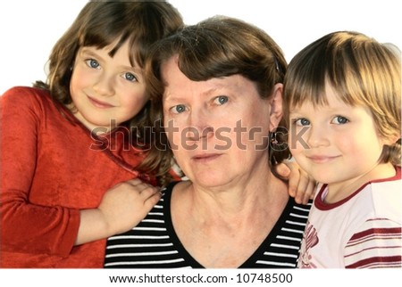 Grandma embraces both their grandchildren.Isolated on a white background.
