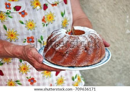 Grandma holding bundt cake hands cooking stock photo royalty free grandma holding a bundt cake with hands cooking cake recipe card vintage food forumfinder Images