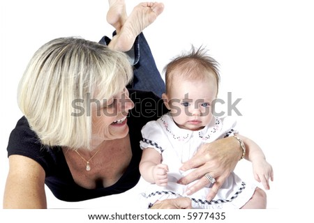 Grandma playing with her little granddaughter - stock photo