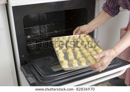 Grandma preparing her cheesepuff recipe (series) - stock photo