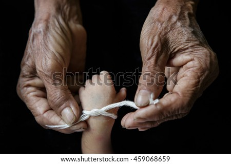 Grandma thread that tied the hands and pray, Lanna Thai Culture