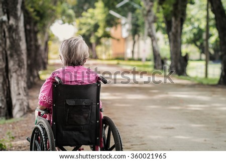 Grandma wheelchair with loneliness  - stock photo