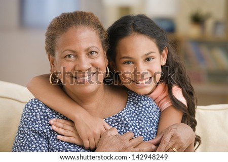 Grandmother and daughter hugging - stock photo