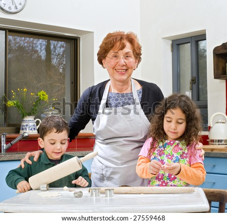 grandmother and grandchild baking cookies together