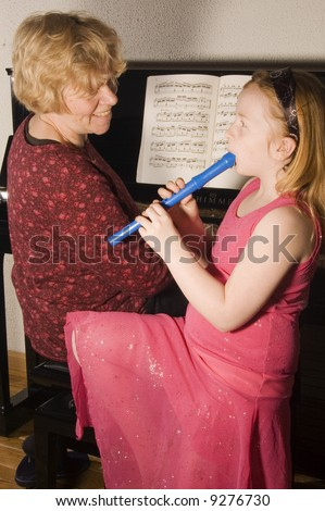 grandmother and grandchild enjoying making music together - stock photo