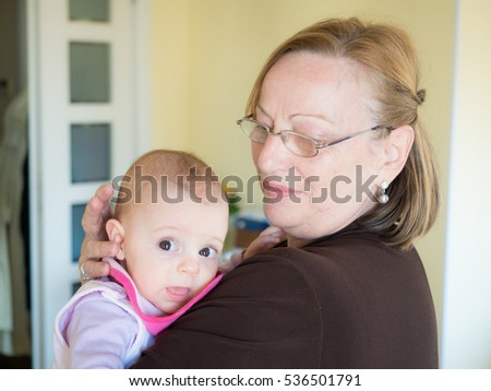 Grandmother and grandchild enjoying some tender moments together.