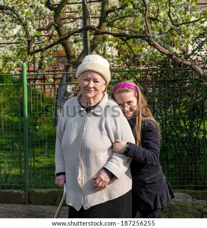 Grandmother and grandchild posing in the garden