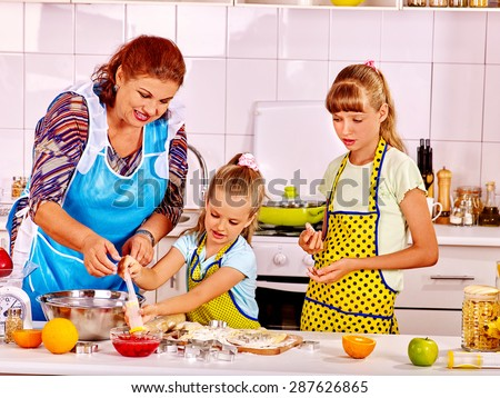 Grandmother and granddaughter baking cookies. - stock photo