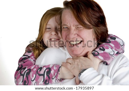 grandmother and granddaughter cuddling each-other - stock photo