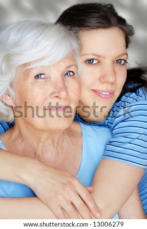 Grandmother and granddaughter embraced and happy - stock photo