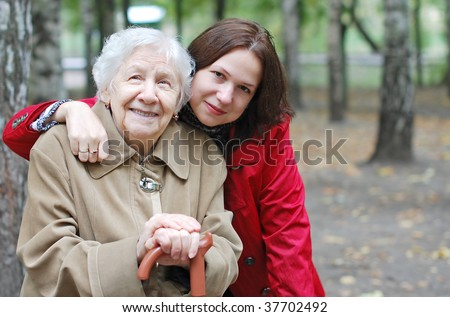 Grandmother and granddaughter embraced and happy