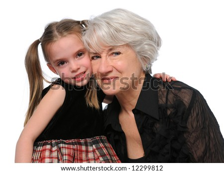 Grandmother and granddaughter embracing isolated over a white background