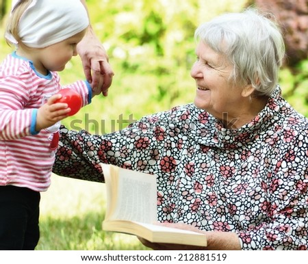 Grandmother and granddaughter. Happy and smiling family.  MANY OTHER PHOTOS FROM THIS SERIES IN MY PORTFOLIO. - stock photo