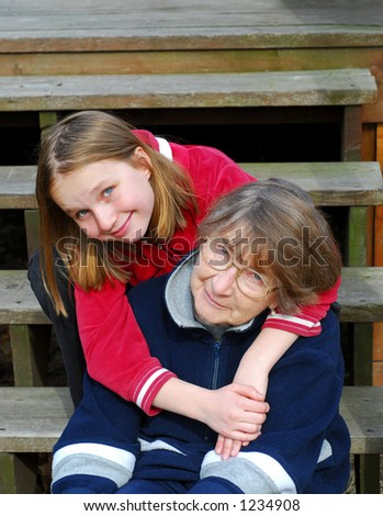 Grandmother and granddaughter happy together - stock photo