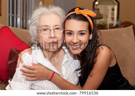 Grandmother and granddaughter in a home setting. - stock photo