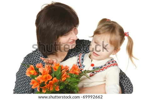 Grandmother and granddaughter looking in details a bunch of flowers isolated on white - stock photo