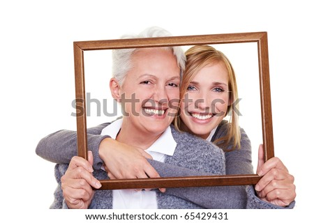 Grandmother and granddaughter looking through an empty frame